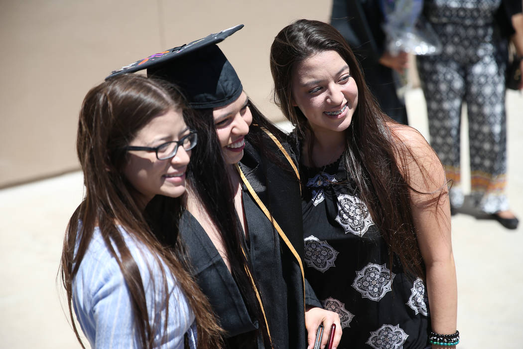 Jacquelyn Trujillo, 18, center, after her graduation from Nevada Virtual Academy, with her sisters Isabella, left, 15, and Francesca, 14, at the Henderson Pavilion in Henderson, Thursday, May 31, ...