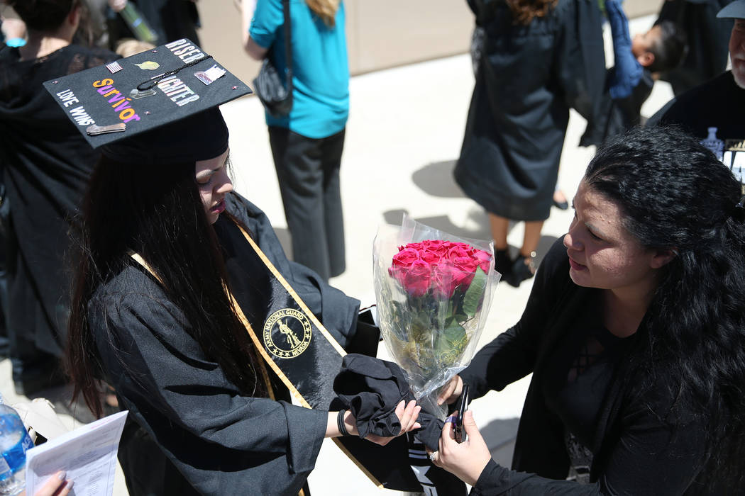 Jacquelyn Trujillo, 18, left, with her mother Sumer Henning, after her graduation from Nevada Virtual Academy at the Henderson Pavilion in Henderson, Thursday, May 31, 2018. Jacquelyn helped her s ...
