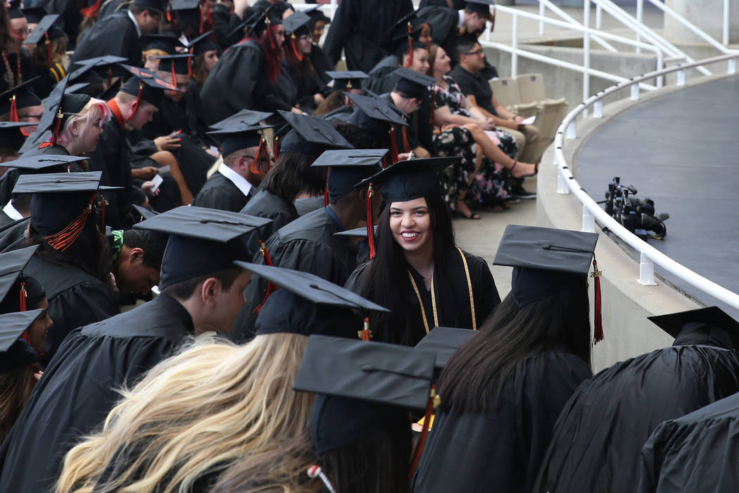 Jacquelyn Trujillo, 18, center, during her graduation from Nevada Virtual Academy at the Henderson Pavilion in Henderson, Thursday, May 31, 2018. Jacquelyn helped her sisters find safety during th ...