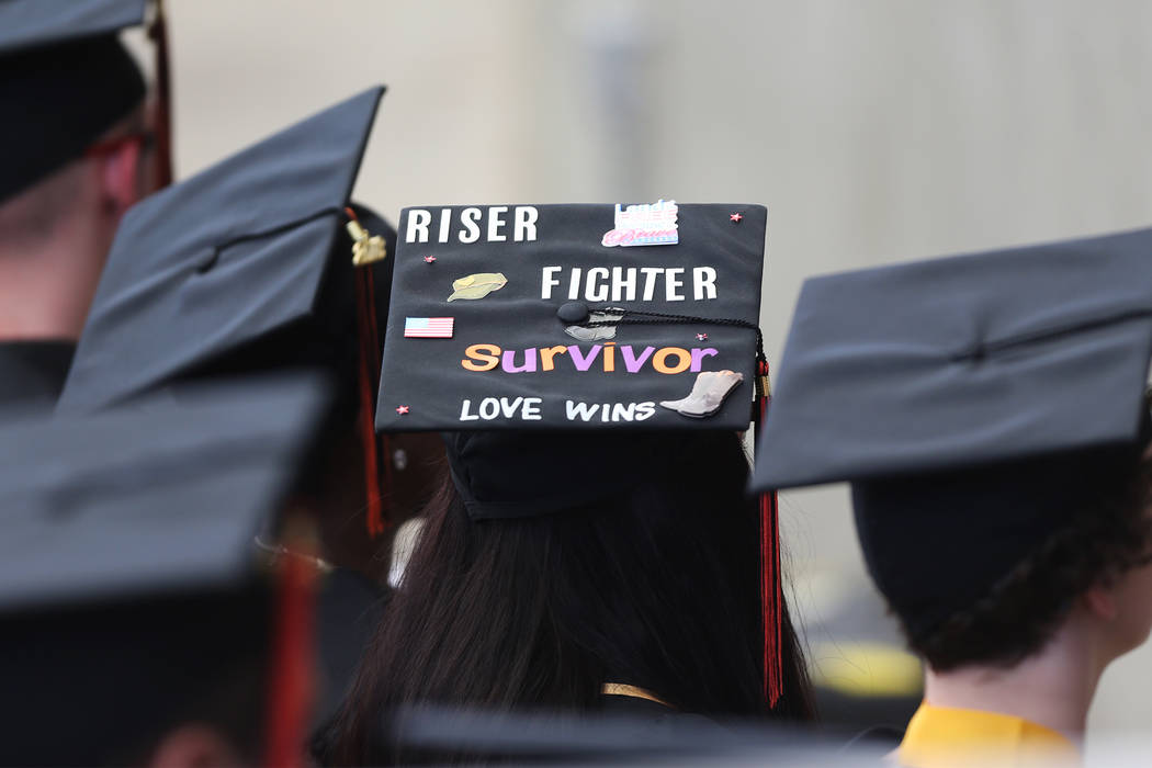 Jacquelyn Trujillo, 18, center, with her decorated cap, during her graduation from Nevada Virtual Academy at the Henderson Pavilion in Henderson, Thursday, May 31, 2018. Jacquelyn helped her siste ...
