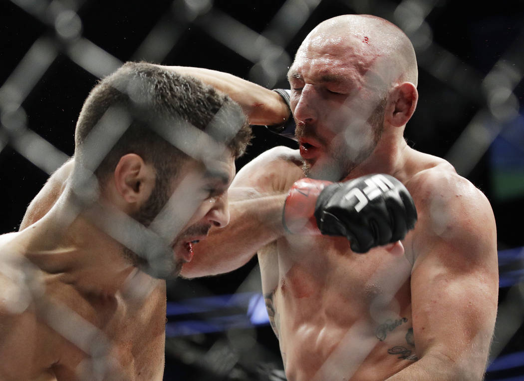 David Teymur, left, of Sweden, and Lando Vannata trade blows during a lightweight mixed martial arts bout at UFC 209, Saturday, March 4, 2017, in Las Vegas. (AP Photo/John Locher)