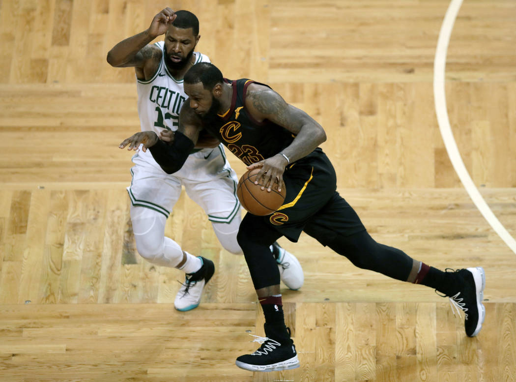 Cleveland Cavaliers forward LeBron James (23) drives against Boston Celtics forward Marcus Morris (13) during the second half in Game 7 of the NBA basketball Eastern Conference finals, Sunday, May ...