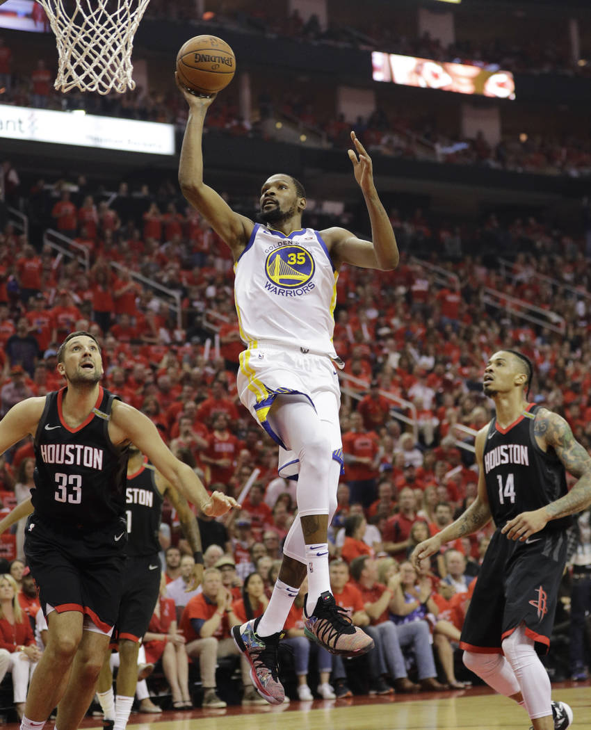 Golden State Warriors forward Kevin Durant (35) drives to the basket past Houston Rockets forward Ryan Anderson (33) during the first half in Game 7 of the NBA basketball Western Conference finals ...