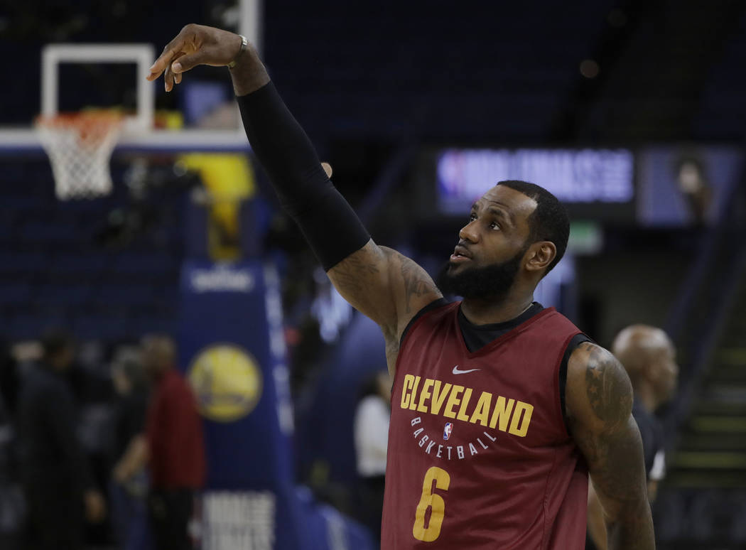 Cleveland Cavaliers' LeBron James follows through on a shot during an NBA basketball practice, Wednesday, May 30, 2018, in Oakland, Calif. The Cavaliers face the Golden State Warriors in Game 1 of ...