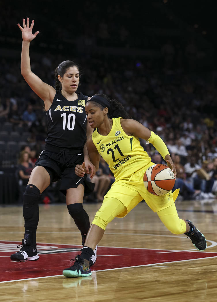 Seattle Storm guard Jordin Canada (21) drives the ball against Las Vegas Aces guard Kelsey Plum (10) in the first half of a WNBA basketball game at the Mandalay Bay Events Center in Las Vegas on S ...