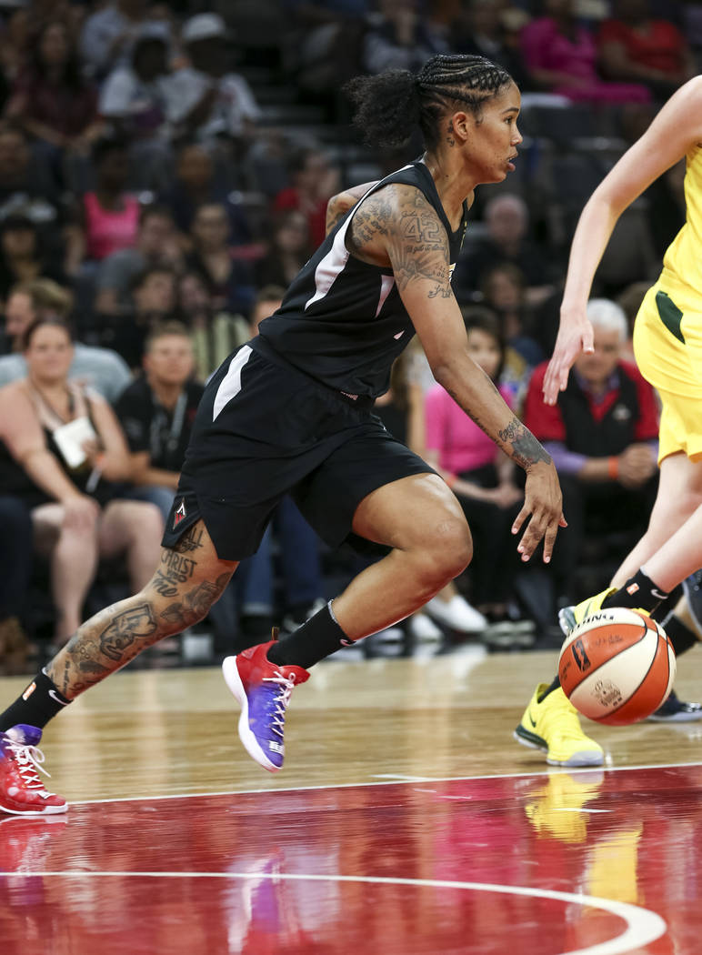 Las Vegas Aces forward Tamera Young (1) dribbles the ball against the Seattle Storm in the first half of a WNBA basketball game at the Mandalay Bay Events Center in Las Vegas on Sunday, May 27, 20 ...