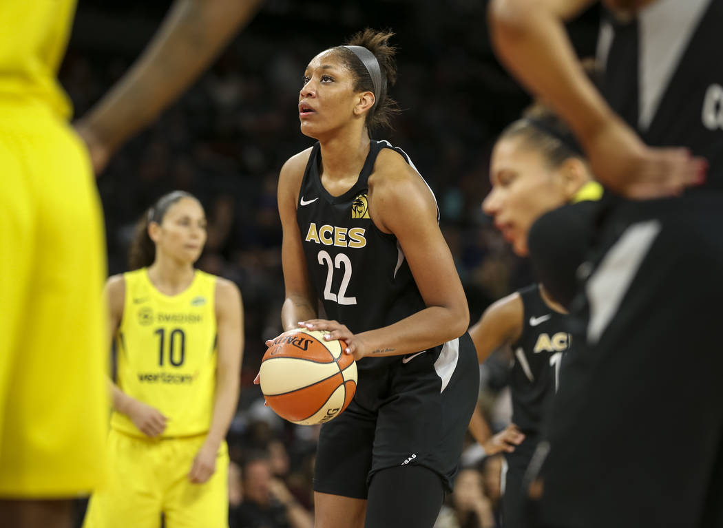 Las Vegas Aces center A'ja Wilson (22) prepares to shoot a free throw against the Seattle Storm in the second half of a WNBA basketball game at the Mandalay Bay Events Center in Las Vegas on Sunda ...