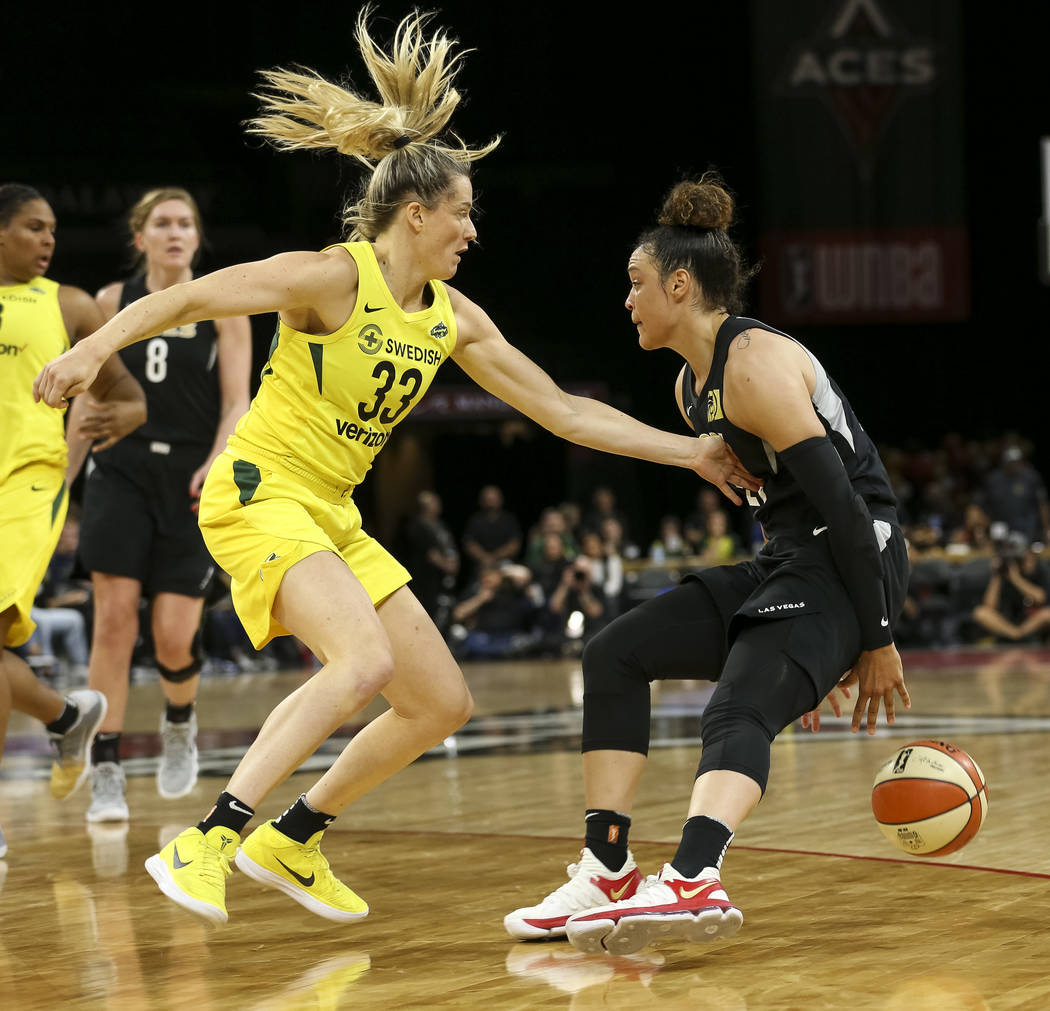 Seattle Storm guard Sami Whitcomb (33) defends against Las Vegas Aces guard Kayla McBride (21) in the second half of a WNBA basketball game at the Mandalay Bay Events Center in Las Vegas on Sunday ...