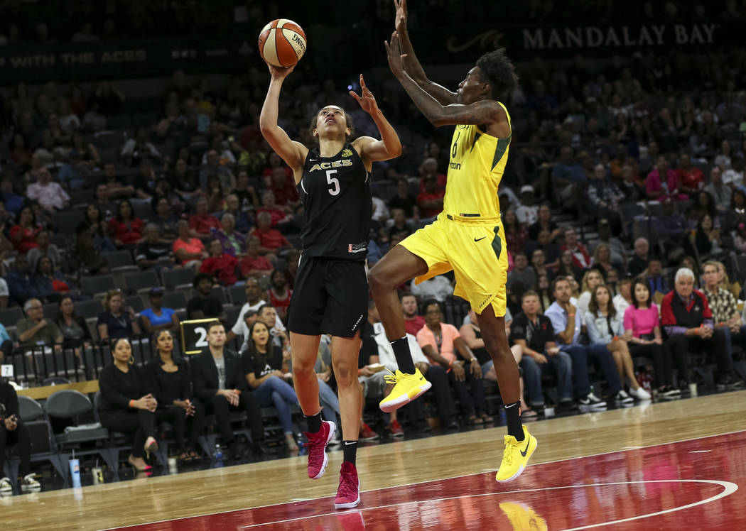 Las Vegas Aces forward Dearica Hamby (5) goes up for a shot against Seattle Storm forward Natasha Howard (6) in the second half of a WNBA basketball game at the Mandalay Bay Events Center in Las V ...