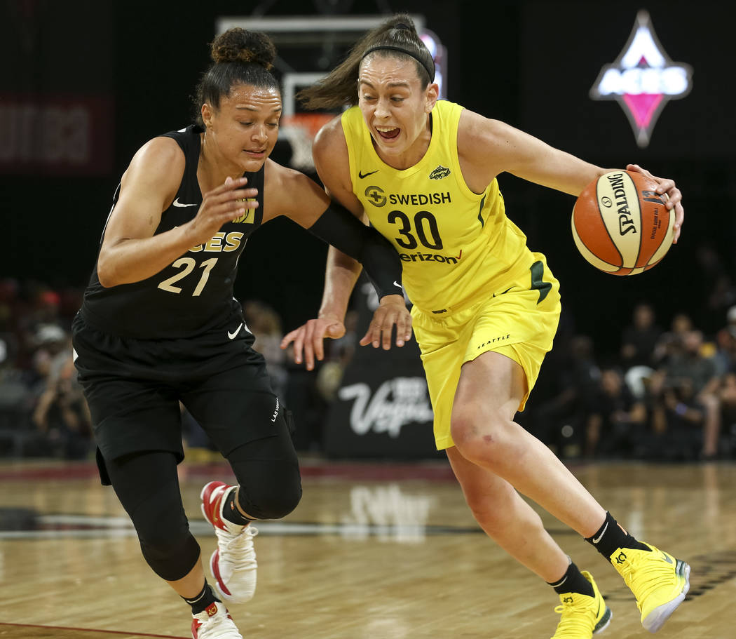 Seattle Storm forward Breanna Stewart (30) drives the ball against Las Vegas Aces guard Kayla McBride (21) in the first half of a WNBA basketball game at the Mandalay Bay Events Center in Las Vega ...