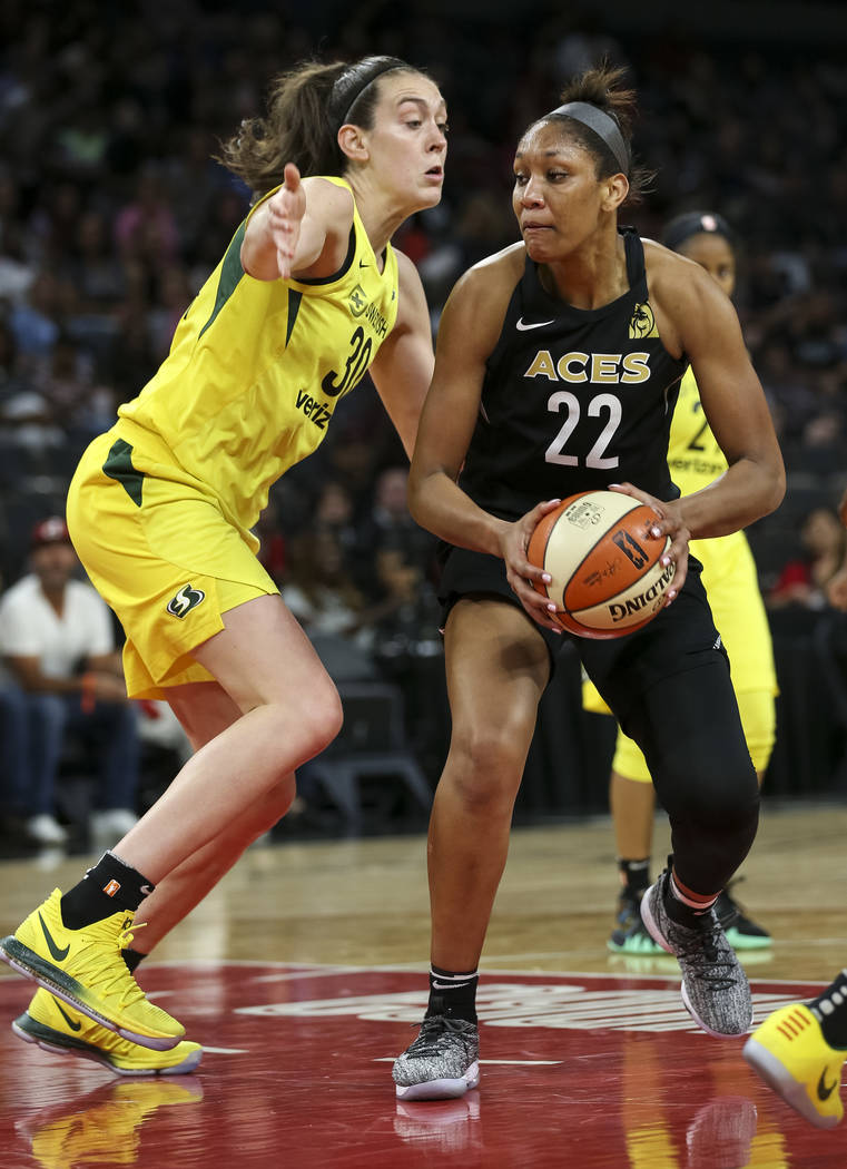 Seattle Storm forward Breanna Stewart (30) defends against Las Vegas Aces center A'ja Wilson (22) in the second half of a WNBA basketball game at the Mandalay Bay Events Center in Las Vegas on Sun ...