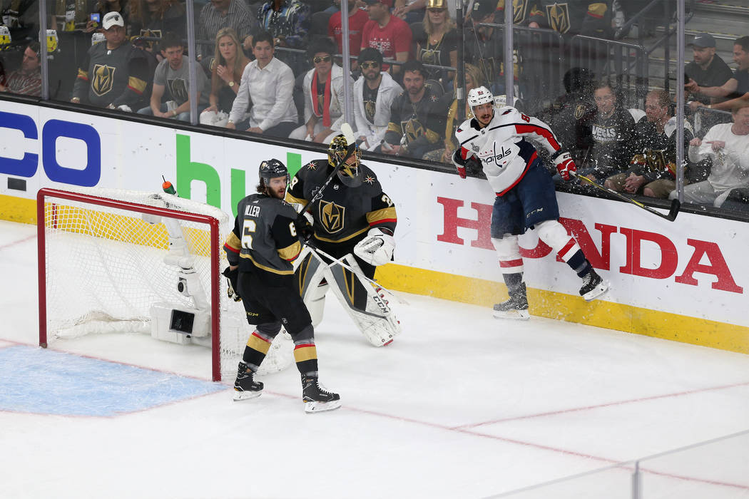 Vegas Golden Knights defenseman Colin Miller (6) ad goaltender Marc-Andre Fleury (29) defend against Washington Capitals center Jay Beagle (83) during the first period in Game 2 of the NHL hockey ...