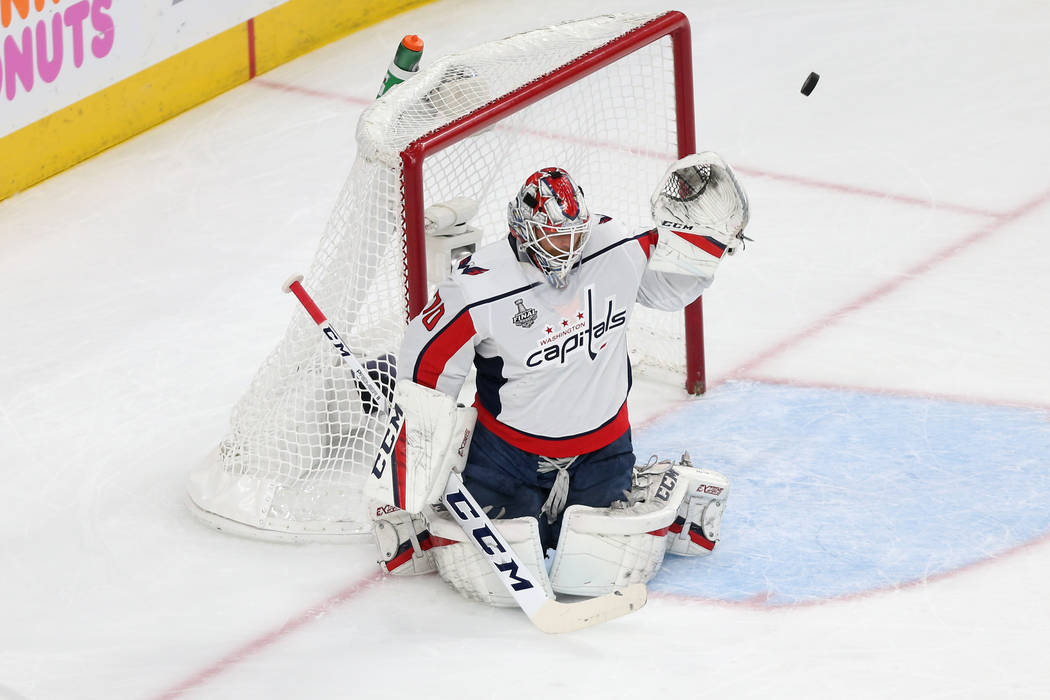 Washington Capitals goaltender Braden Holtby (70) defends a shot against Vegas Golden Knights left wing Erik Haula (56) during the first period in Game 2 of the NHL hockey Stanley Cup Final at T-M ...