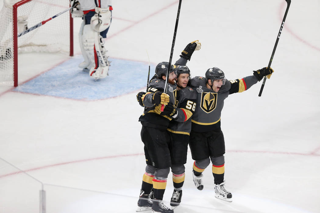 Vegas Golden Knights left wing James Neal (18) celebrates his score with left wing Erik Haula (56) and left wing David Perron (57) against Washington Capitals during the first period in Game 2 of ...