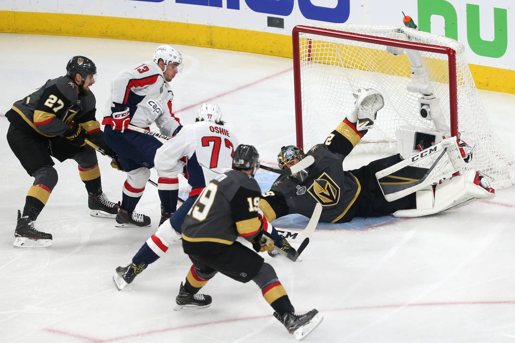 Vegas Golden Knights goaltender Marc-Andre Fleury (29) dives for a save against Washington Capitals during the first period in Game 2 of the NHL hockey Stanley Cup Final at T-Mobile Arena in Las V ...