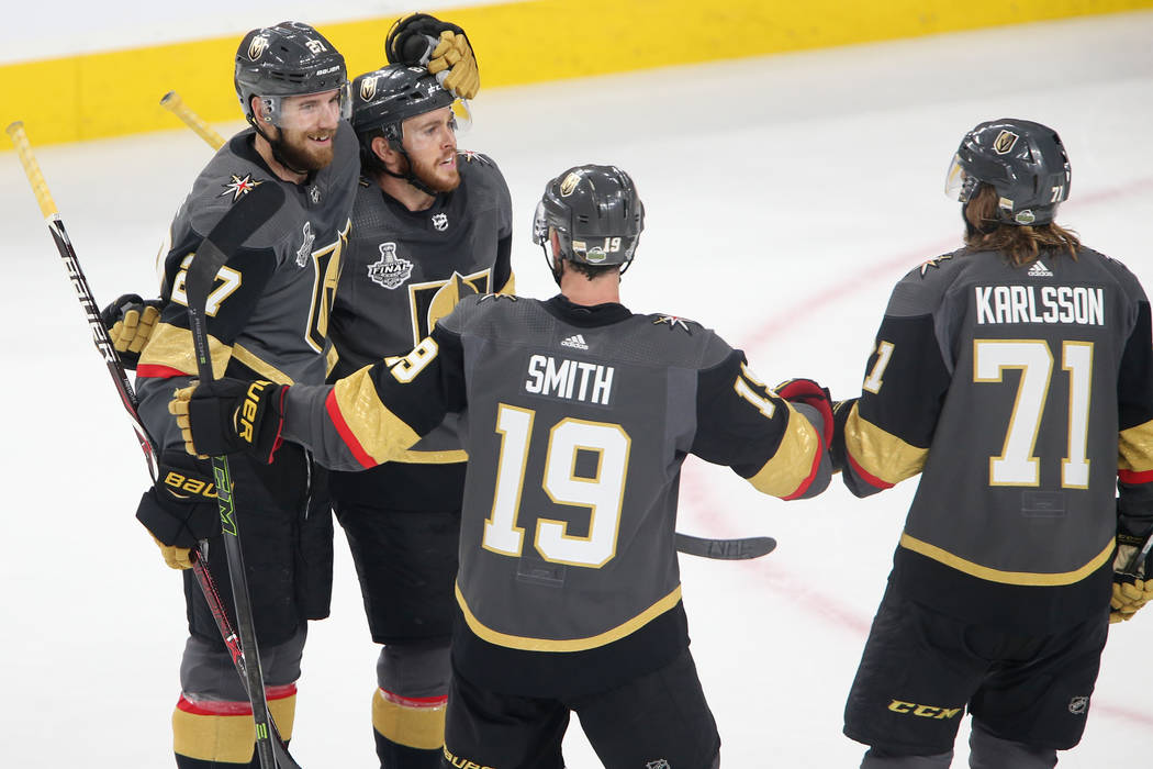 Vegas Golden Knights defenseman Shea Theodore (27) celebrates his score with center Jonathan Marchessault (81), right wing Reilly Smith (19) and center William Karlsson (71) against Washington Cap ...