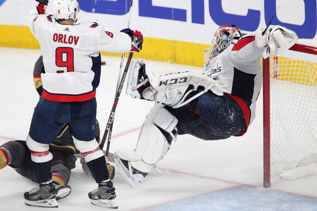 Washington Capitals goaltender Braden Holtby (70) takes a fall during the second period against Vegas Golden Knights in Game 2 of the NHL hockey Stanley Cup Final at T-Mobile Arena in Las Vegas, W ...