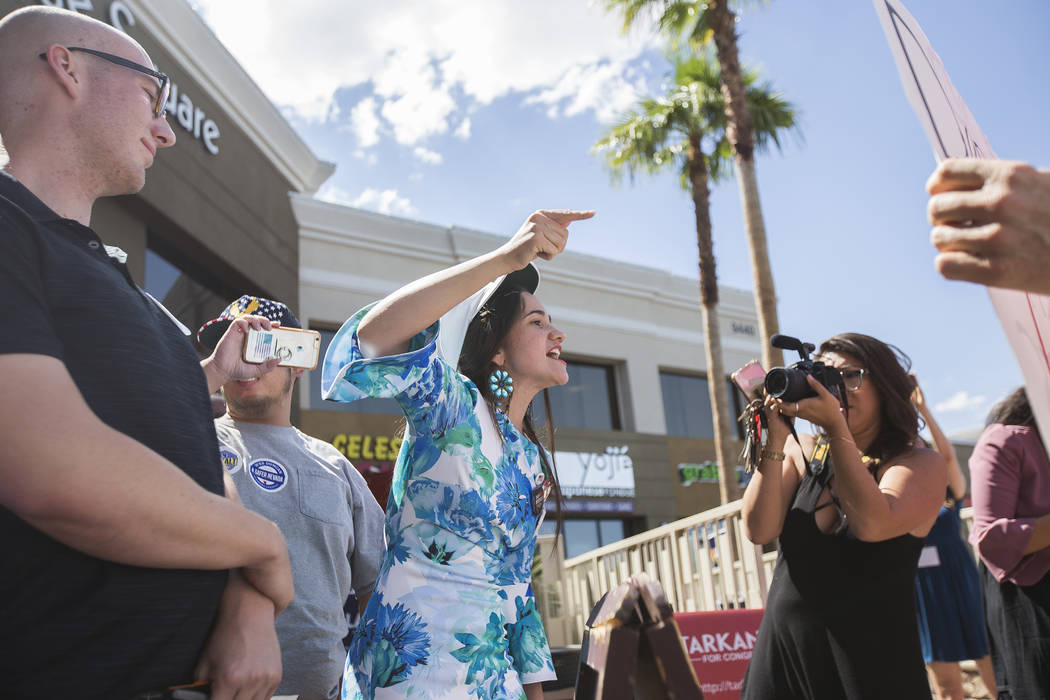 "Celeste McWhorter yells at protestors at a ""Get-Out-The-Vote"" campaign at Avery's Coffee Shop in Las Vegas, Wednesday, May 30, 2018. Adam Laxalt, a Republican running for Governor, and D ..."
