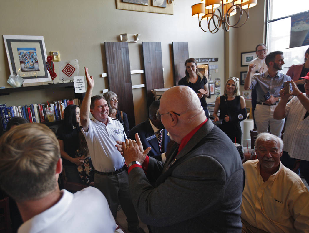 "Jim Small, a Republican running for Nevada Assembly District 2, greets the crowd of applause at a ""Get-Out-The-Vote"" campaign at Avery's Coffee Shop in Las Vegas, Wednesday, May 30, 2018 ..."