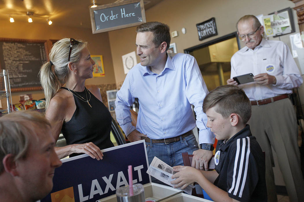 "Cynthia Ross speaks to her cousin Adam Laxalt, a Republican running for Governor, next to her son Jansen Ross, 11, at a ""Get-Out-The-Vote"" campaign at Avery's Coffee Shop in Las Vegas, W ..."