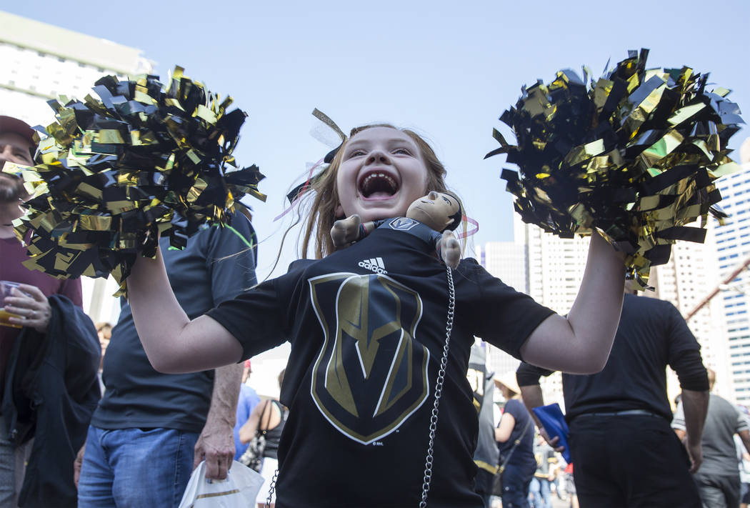 Golden Knights fan Brighid Churches cheers for Vegas outside T-Mobile Arena before the start of Game 2 of the NHL Stanley Cup Finals with the Washington Capitals on Wednesday, May 30, 2018, at T-M ...