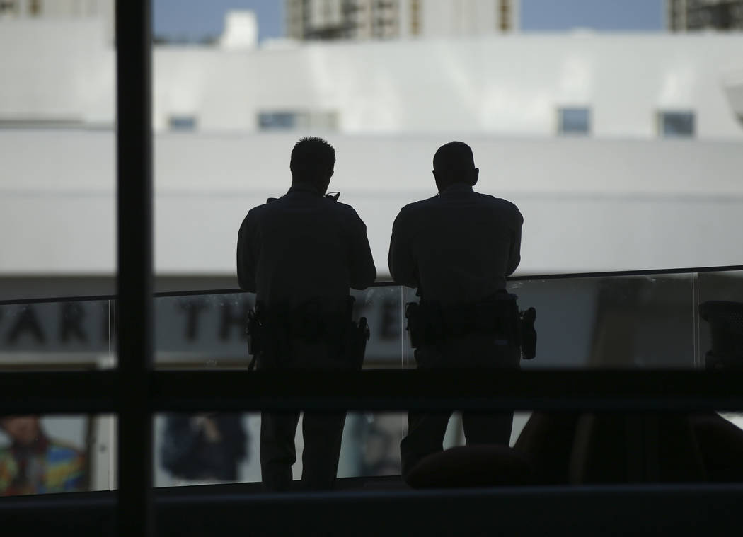 Metropolitan Police Department officers watch the crowd from a balcony before the start of Game 2 of the NHL hockey Stanley Cup Final between the Golden Knights and Washington Capitals at the T-Mo ...