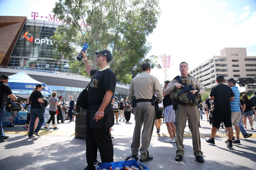 Las Vegas police officers keep watch at Toshiba Plaza before Game 1 of the NHL hockey Stanley Cup Finals at T-Mobile Arena in Las Vegas, Wednesday, May 30, 2018. Erik Verduzco Las Vegas Review-Jou ...