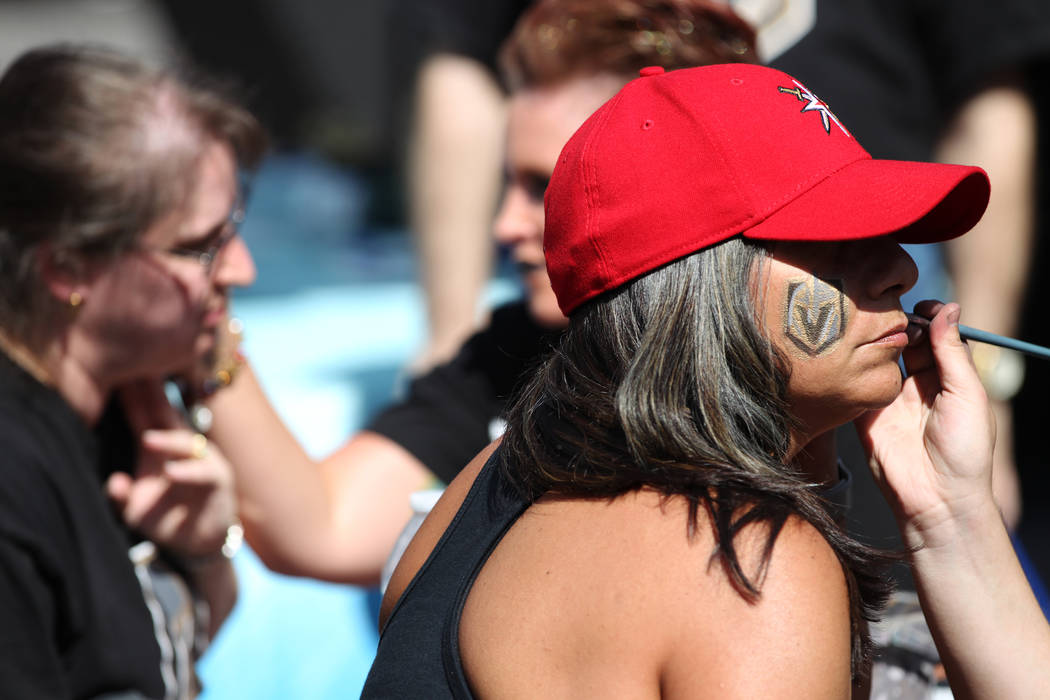Abby Gerardi of Las Vegas gets her face painted before Game 1 of the NHL hockey Stanley Cup Finals at T-Mobile Arena in Las Vegas, Wednesday, May 30, 2018. Erik Verduzco Las Vegas Review-Journal @ ...
