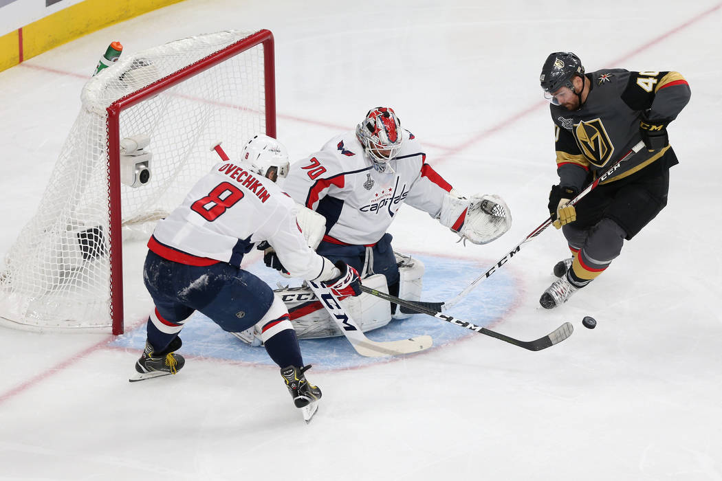 Vegas Golden Knights center Ryan Carpenter (40) looks for a shot against Washington Capitals goaltender Braden Holtby (70) and left wing Alex Ovechkin (8) during the first period in Game 2 of the ...