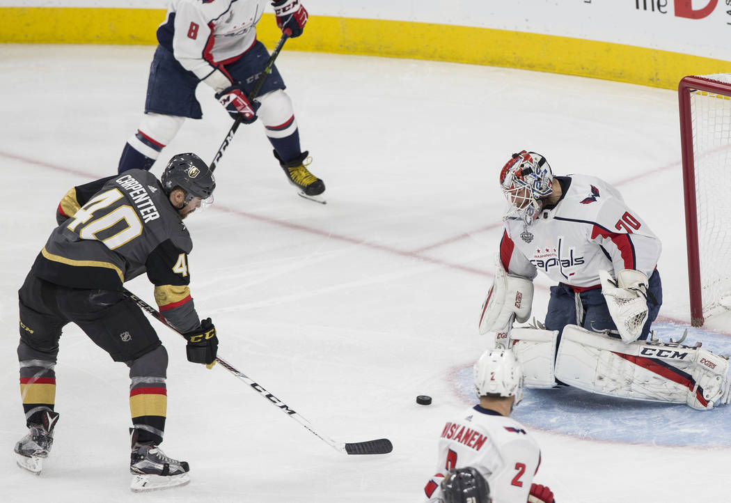 Golden Knights center Ryan Carpenter (40) shoots on Capitals goaltender Braden Holtby (70) in the first period during Game 2 of the NHL Stanley Cup Final on Wednesday, May 30, 2018, at T-Mobile Ar ...
