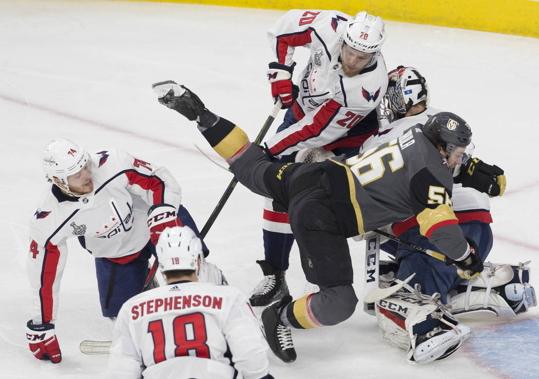 Golden Knights left wing Erik Haula (56) collides with Capitals goaltender Braden Holtby (70) in the first period during Game 2 of the NHL Stanley Cup Final on Wednesday, May 30, 2018, at T-Mobile ...
