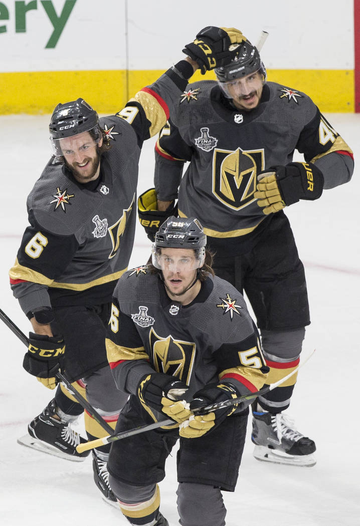 Golden Knights defenseman Colin Miller (6), defenseman Luca Sbisa (47) and left wing Erik Haula (56) celebrate after left wing James Neal (18) scored a first-period goal against the Washington Cap ...