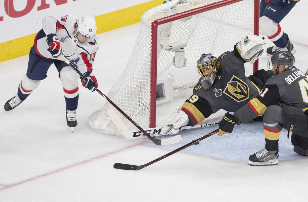 Golden Knights goaltender Marc-Andre Fleury (29) makes a save against Capitals left wing Jakub Vrana (13) in the first period during Game 2 of the NHL Stanley Cup Final on Wednesday, May 30, 2018, ...