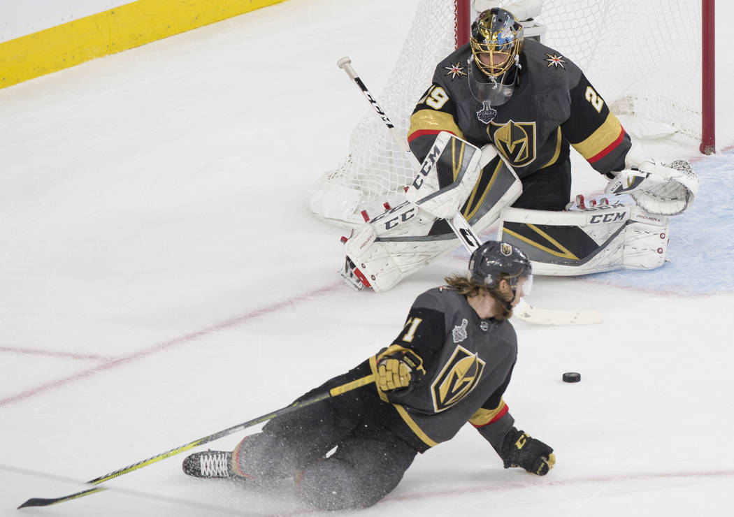 Golden Knights goaltender Marc-Andre Fleury (29) makes a save with the help of center William Karlsson (71) in the first period during Game 2 of the NHL Stanley Cup Final with the Washington Capit ...