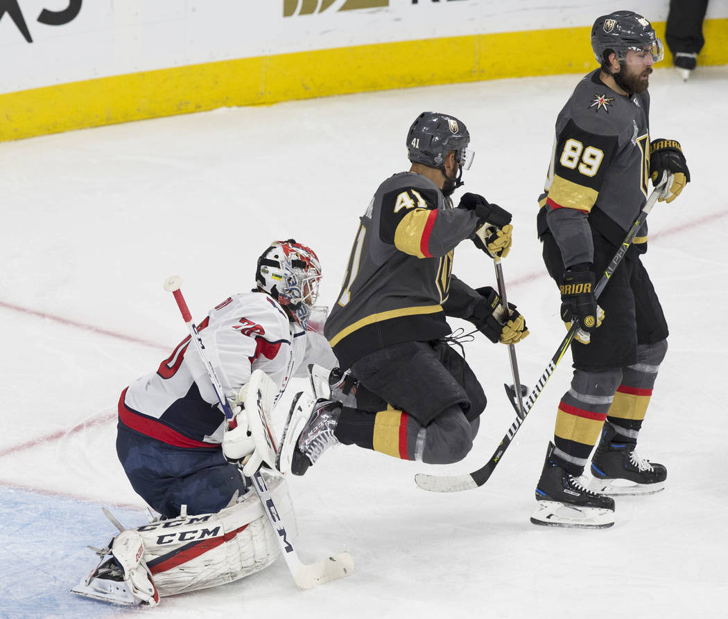 Golden Knights right wing Pierre-Edouard Bellemare (41) jumps to deflect a shot on Capitals goaltender Braden Holtby (70) in the second period during Game 2 of the NHL Stanley Cup Final on Wednesd ...