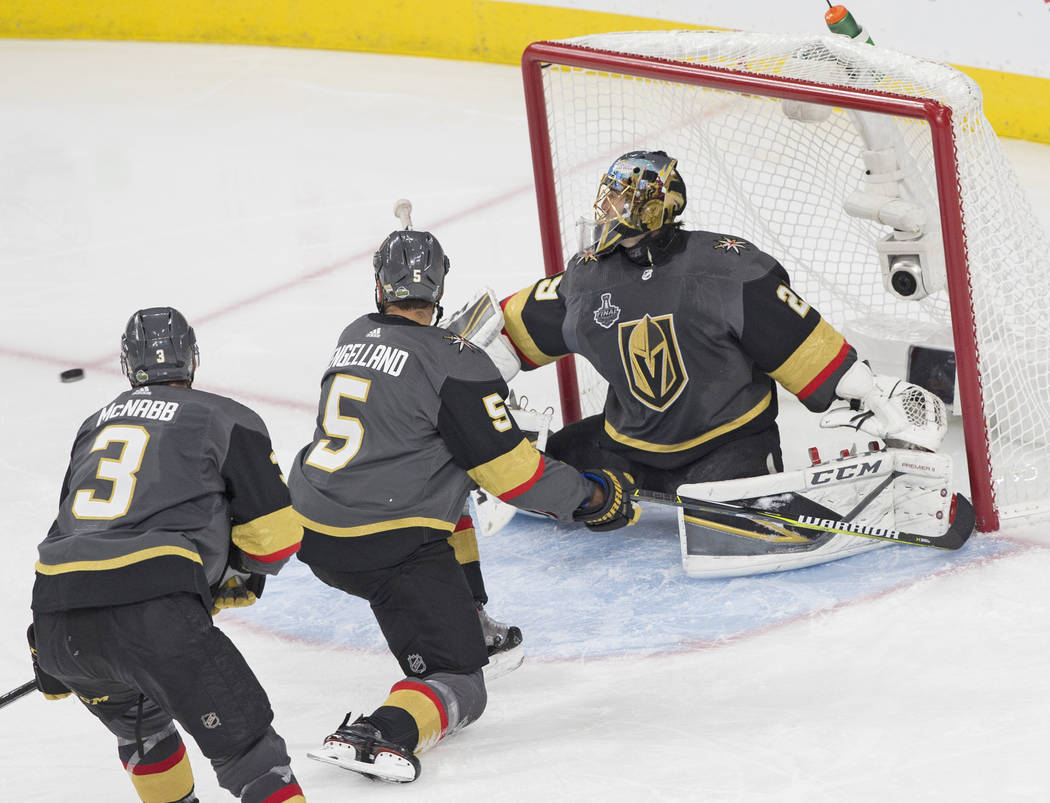 Golden Knights goaltender Marc-Andre Fleury (29) makes a save with the help of Deryk Engelland (5) and Brayden McNabb (3) in the second period during Game 2 of the NHL Stanley Cup Final with the W ...