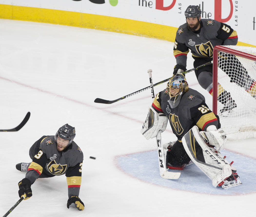 Golden Knights goaltender Marc-Andre Fleury (29) makes a save with the help of Brayden McNabb (3) in the second period during Game 2 of the NHL Stanley Cup Final with the Washington Capitals on We ...