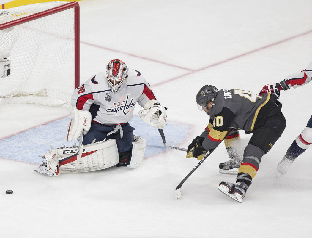 Golden Knights center Ryan Carpenter (40) shoots on Capitals goaltender Braden Holtby (70) in the second period during Game 2 of the NHL Stanley Cup Final on Wednesday, May 30, 2018, at T-Mobile A ...