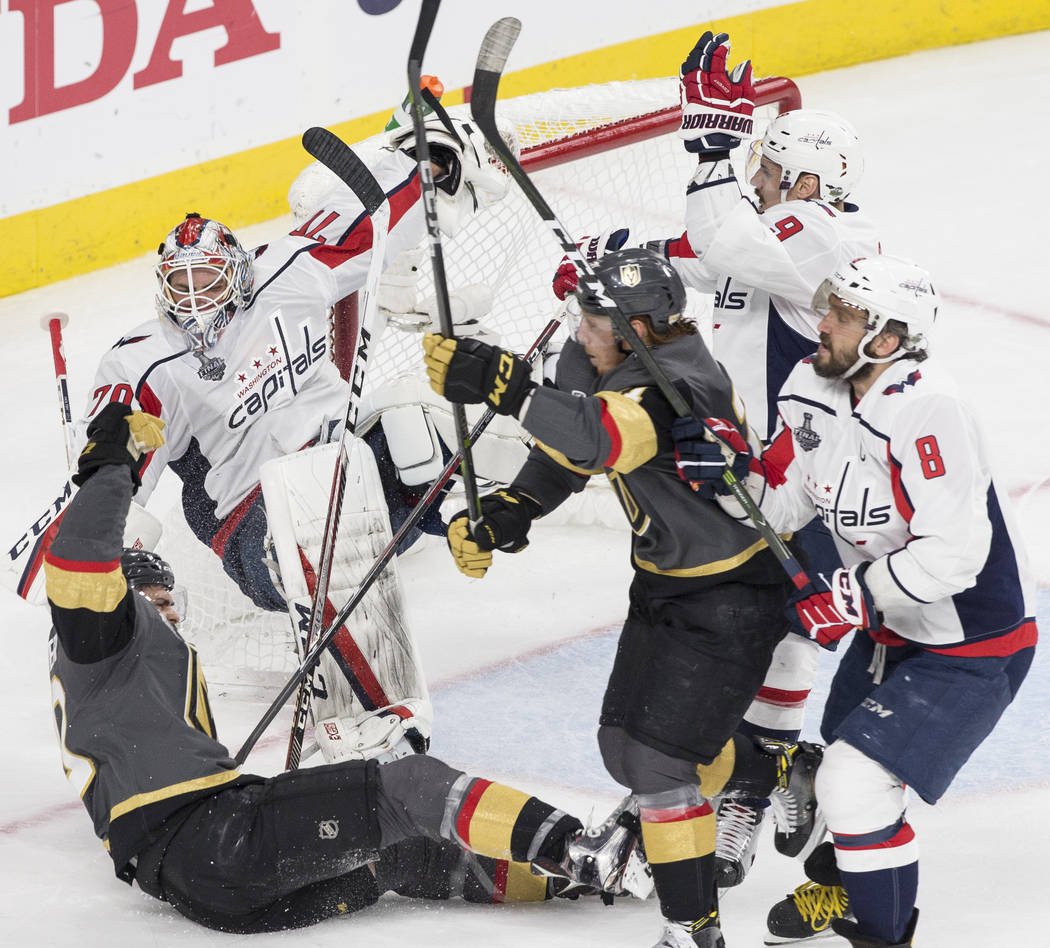 Golden Knights center Ryan Carpenter (40) collides with Capitals goaltender Braden Holtby (70) in the second period during Game 2 of the NHL Stanley Cup Final on Wednesday, May 30, 2018, at T-Mob ...