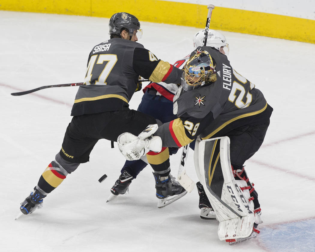 Golden Knights goaltender Marc-Andre Fleury (29) makes a save with the help of defenseman Luca Sbisa (47) in the second period during Game 2 of the NHL Stanley Cup Final with the Washington Capita ...