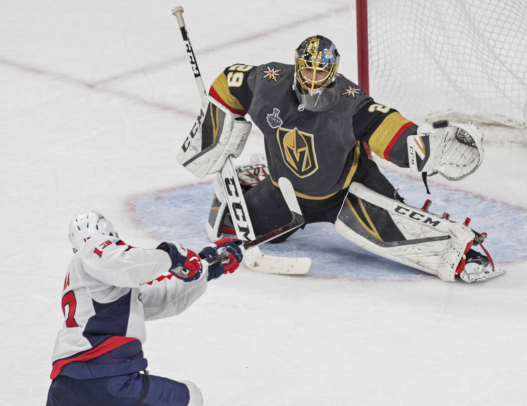 Golden Knights goaltender Marc-Andre Fleury (29) makes a glove save against Capitals left wing Jakub Vrana (13) in the second period during Game 2 of the NHL Stanley Cup Final on Wednesday, May 30 ...