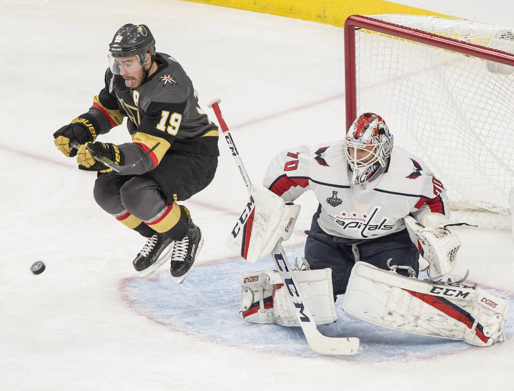 Golden Knights right wing Reilly Smith (19) jumps to try and redirect a shot on Capitals goaltender Braden Holtby (70) in the third period during Game 2 of the NHL Stanley Cup Final on Wednesday, ...