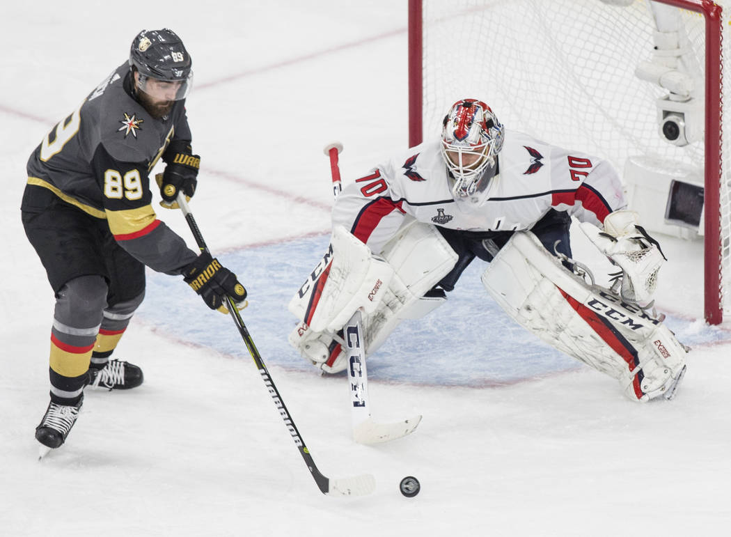 Golden Knights right wing Alex Tuch (89) shoots on Capitals goaltender Braden Holtby (70) in the third period during Game 2 of the NHL Stanley Cup Final on Wednesday, May 30, 2018, at T-Mobile Are ...