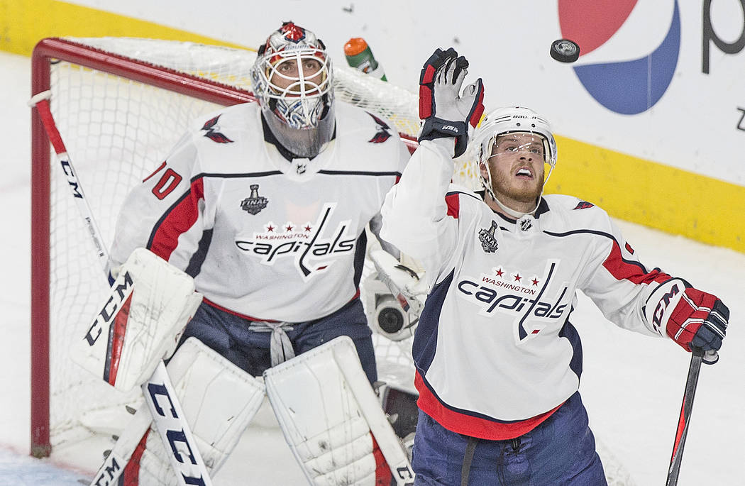 Capitals defenseman John Carlson (74) knocks down a shot before it can reach goaltender Braden Holtby (70) in the third period of Game 2 of the NHL Stanley Cup Final against the Golden Knights on ...