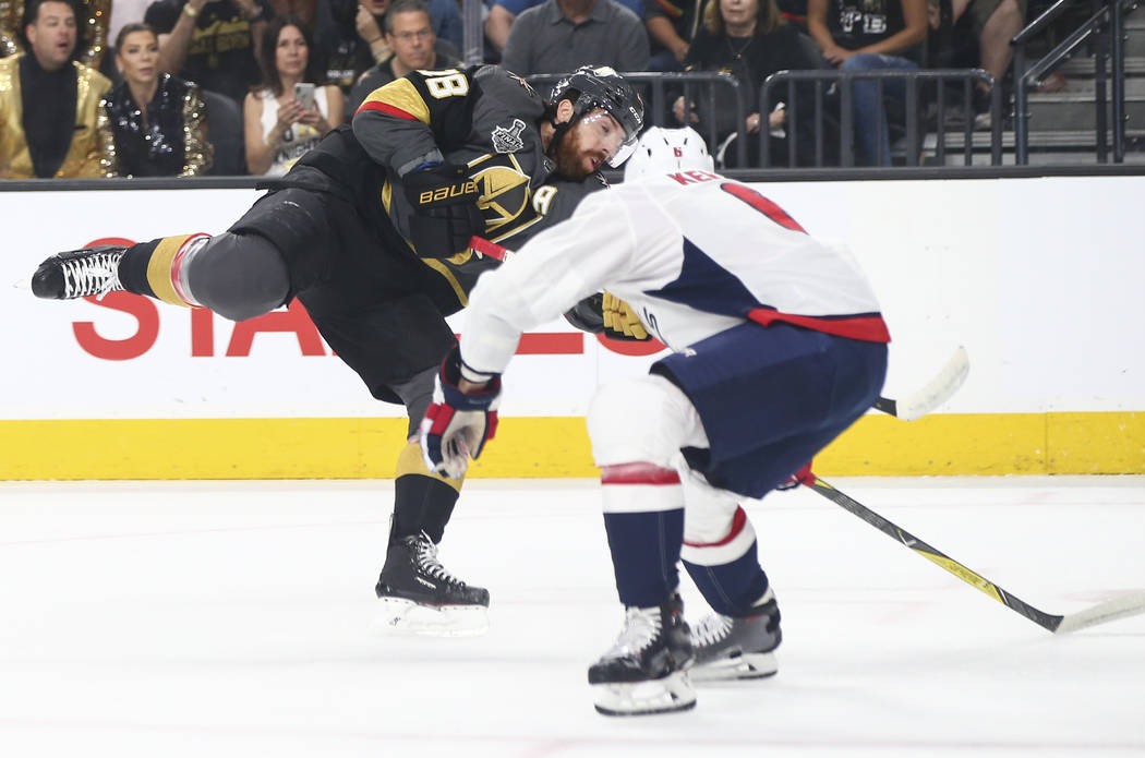 Golden Knights left wing James Neal (18) shoots pastWashington Capitals defenseman Michal Kempny (6) to score against the Washington Capitals during the first period of Game 2 of the NHL hockey St ...