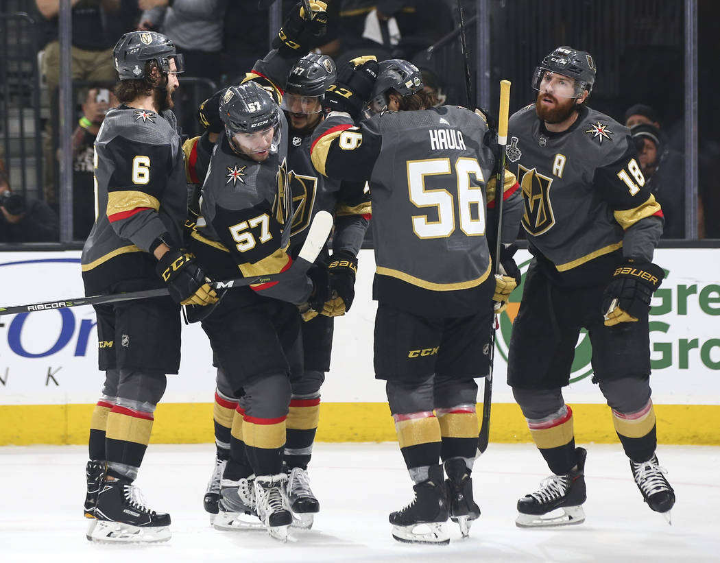 Golden Knights players celebrate a goal by Golden Knights left wing James Neal (18) during the first period of Game 2 of the NHL hockey Stanley Cup Final at the T-Mobile Arena in Las Vegas on Wedn ...