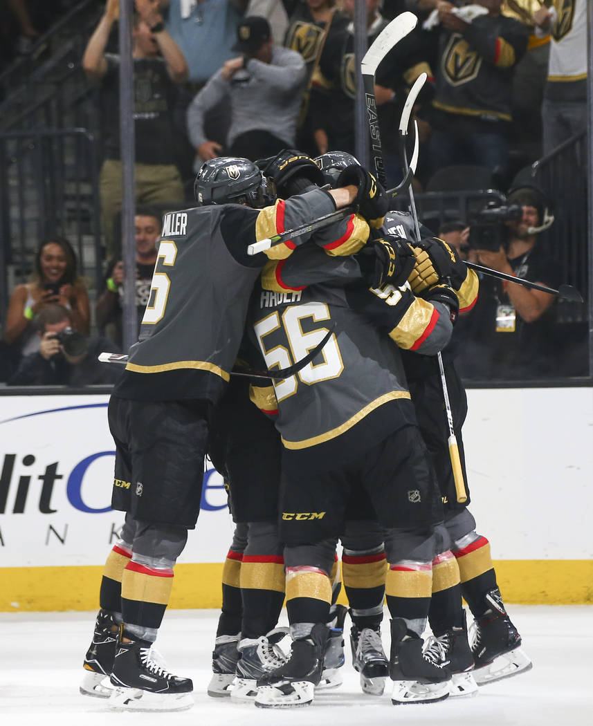 Golden Knights players celebrate a goal by Golden Knights left wing James Neal during the first period of Game 2 of the NHL hockey Stanley Cup Final at the T-Mobile Arena in Las Vegas on Wednesday ...