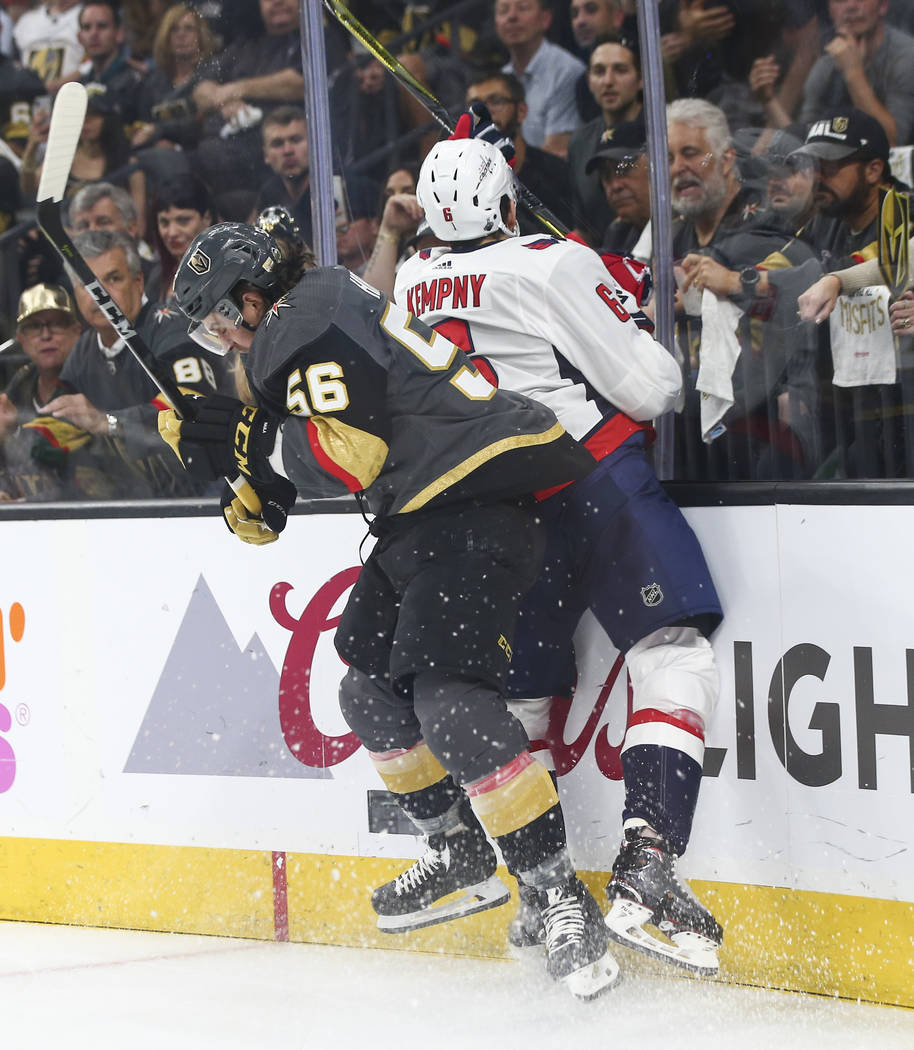 Washington Capitals defenseman Michal Kempny (6) gets slammed into the glass by Golden Knights left wing Erik Haula (56) during the first period of Game 2 of the NHL hockey Stanley Cup Final at th ...