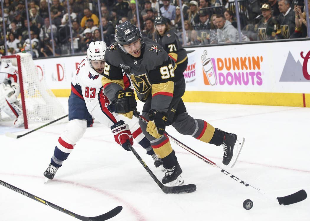 Golden Knights left wing Tomas Nosek (92) controls the puck as Washington Capitals center Jay Beagle (83) defends during the first period of Game 2 of the NHL hockey Stanley Cup Final at the T-Mob ...