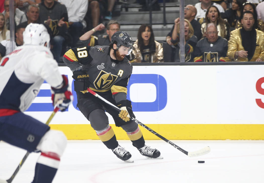 Golden Knights left wing James Neal (18) lines up his shot before scoring against the Washington Capitals during the first period of Game 2 of the NHL hockey Stanley Cup Final at the T-Mobile Aren ...